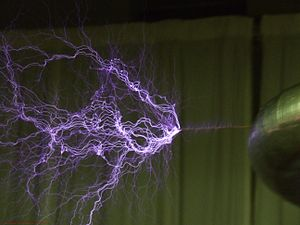 Electric field breakdown of air by a tesla coil